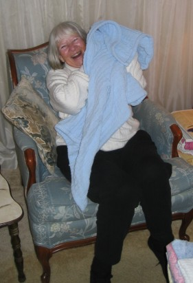 This is great grandma Gen holding a bundle of blankets that she purports to be Mason.