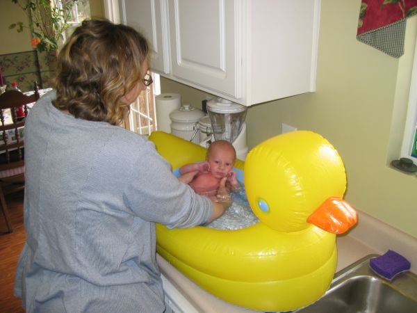 We've undertaken training Mason to be the next Esther Williams. The breasts and vagina might be difficult, but we think we can get the swimming bit down, at least. Or is this his first bath?